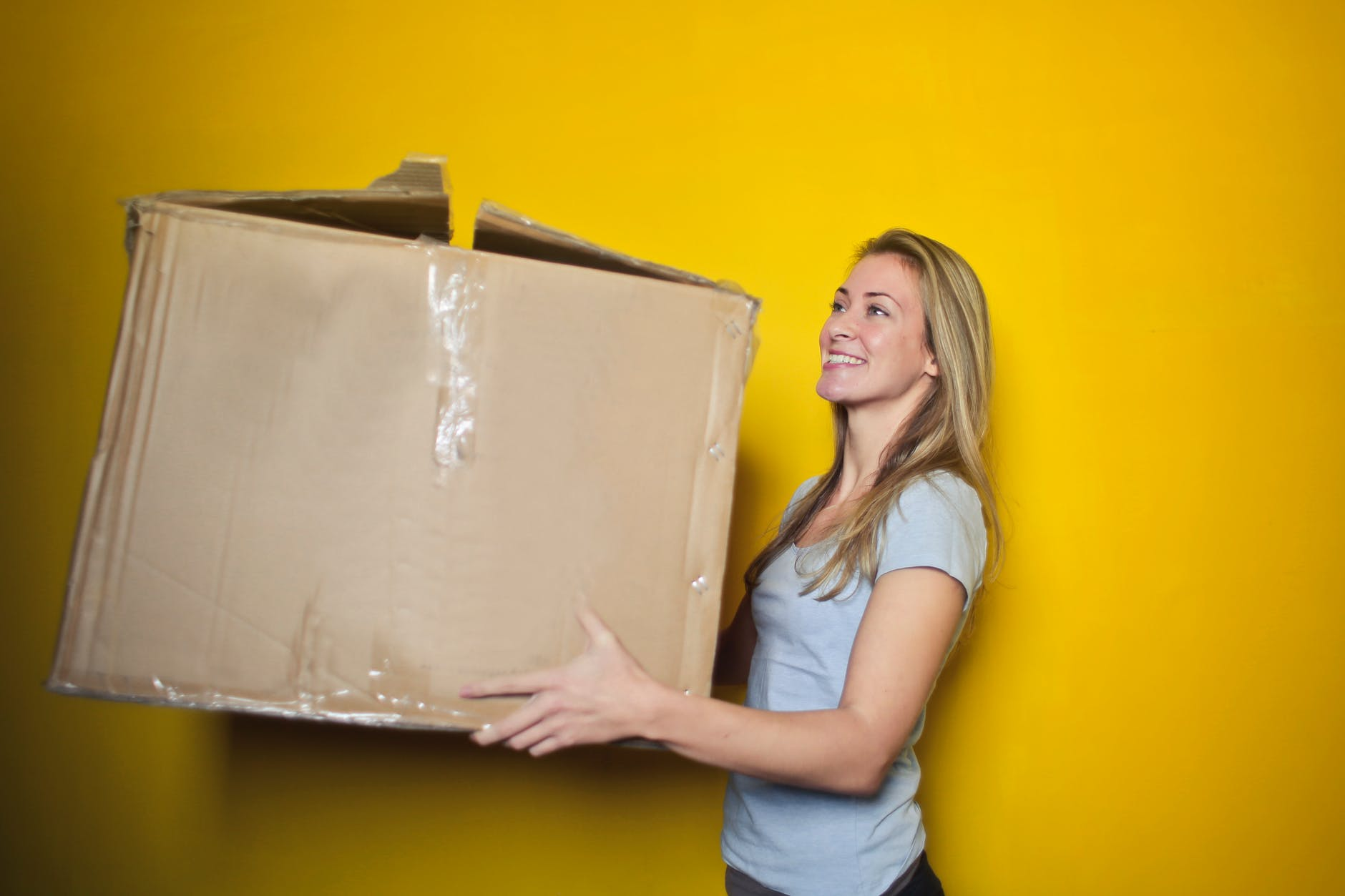 moving - woman with a box